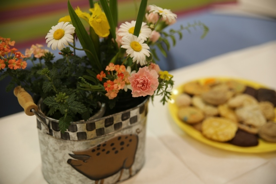 Photo of a flower bouquet and plate of cookies